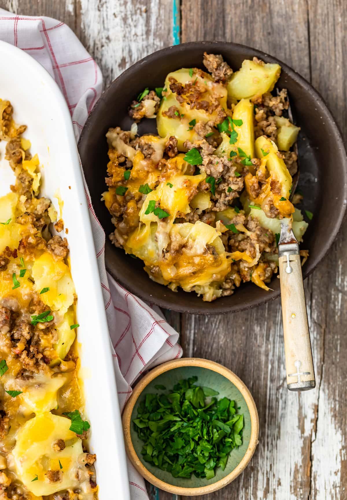 a bowl of cheesy sausage potato casserole