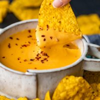 Nacho Cheese Sauce is something everyone should be able to make. An easy cheese dip (made in 5 minutes!) always comes in handy! This homemade nacho cheese sauce recipe is so delicious and so quick. Make it in a flash, dip in some chips, or use this versatile cheese sauce on all kinds of recipes!