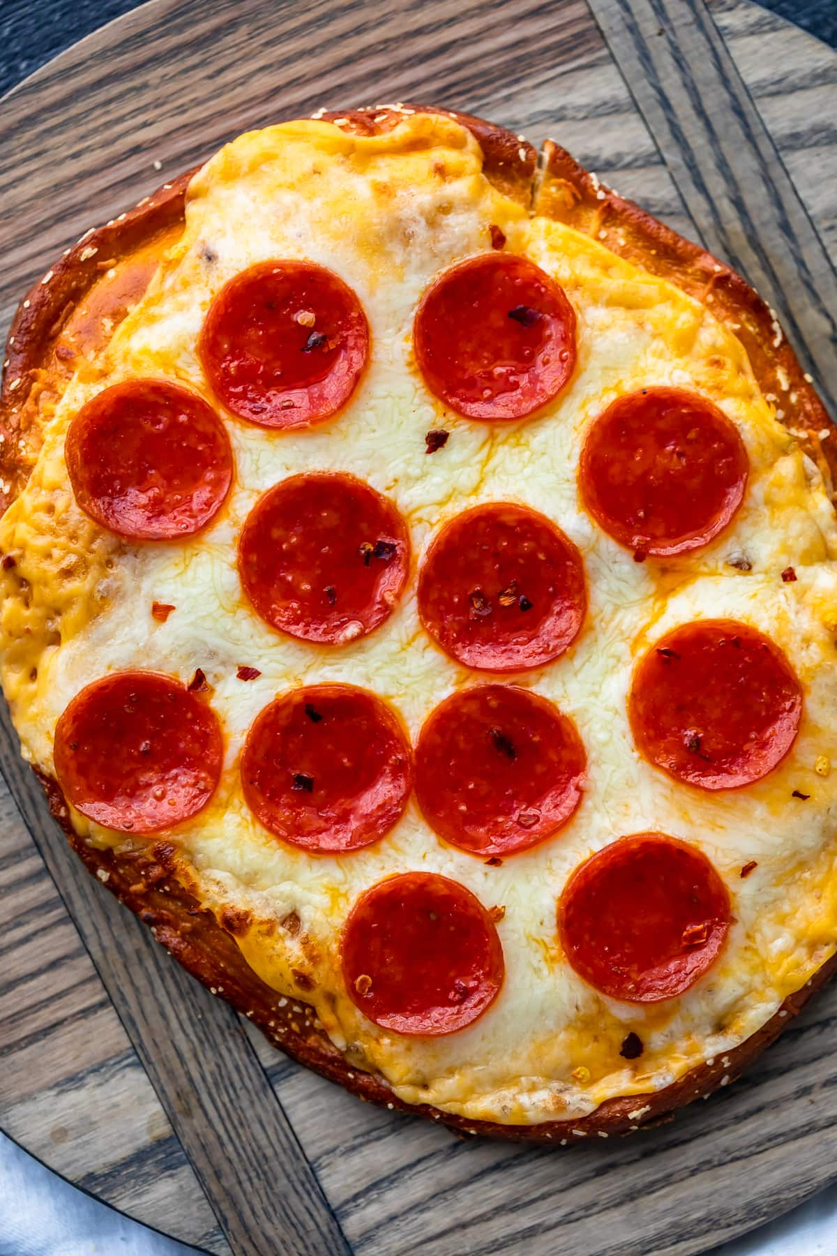 soft pretzel crust with cheese sauce and pepperonis