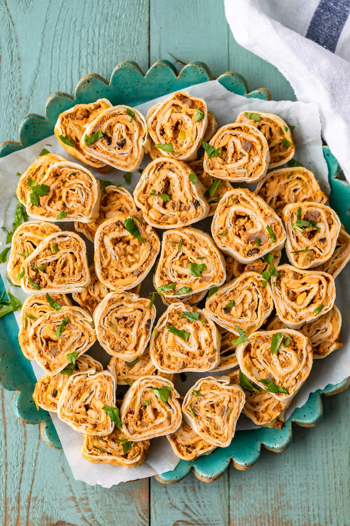 southwest sausage pinwheels on a turquoise serving plate