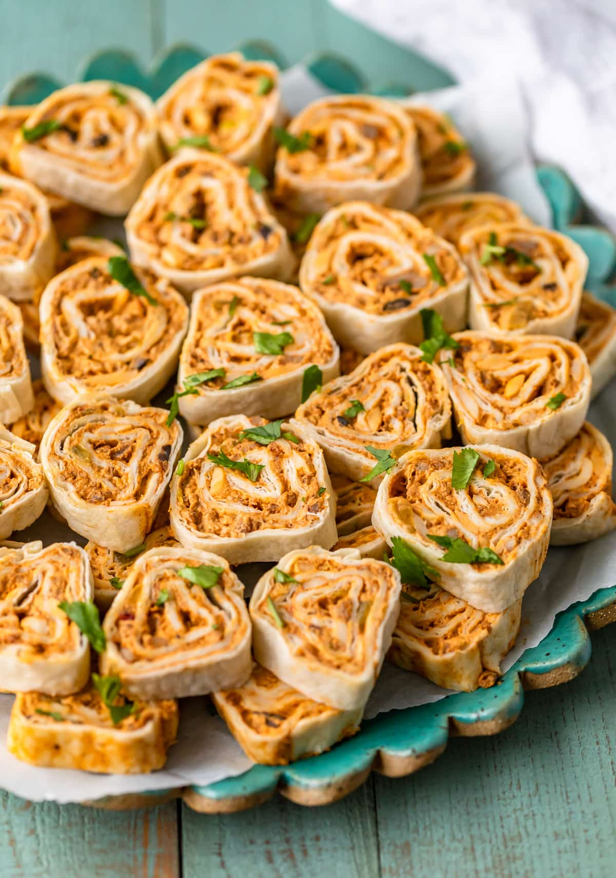 sausage cream cheese pinwheels stacked on a serving plate