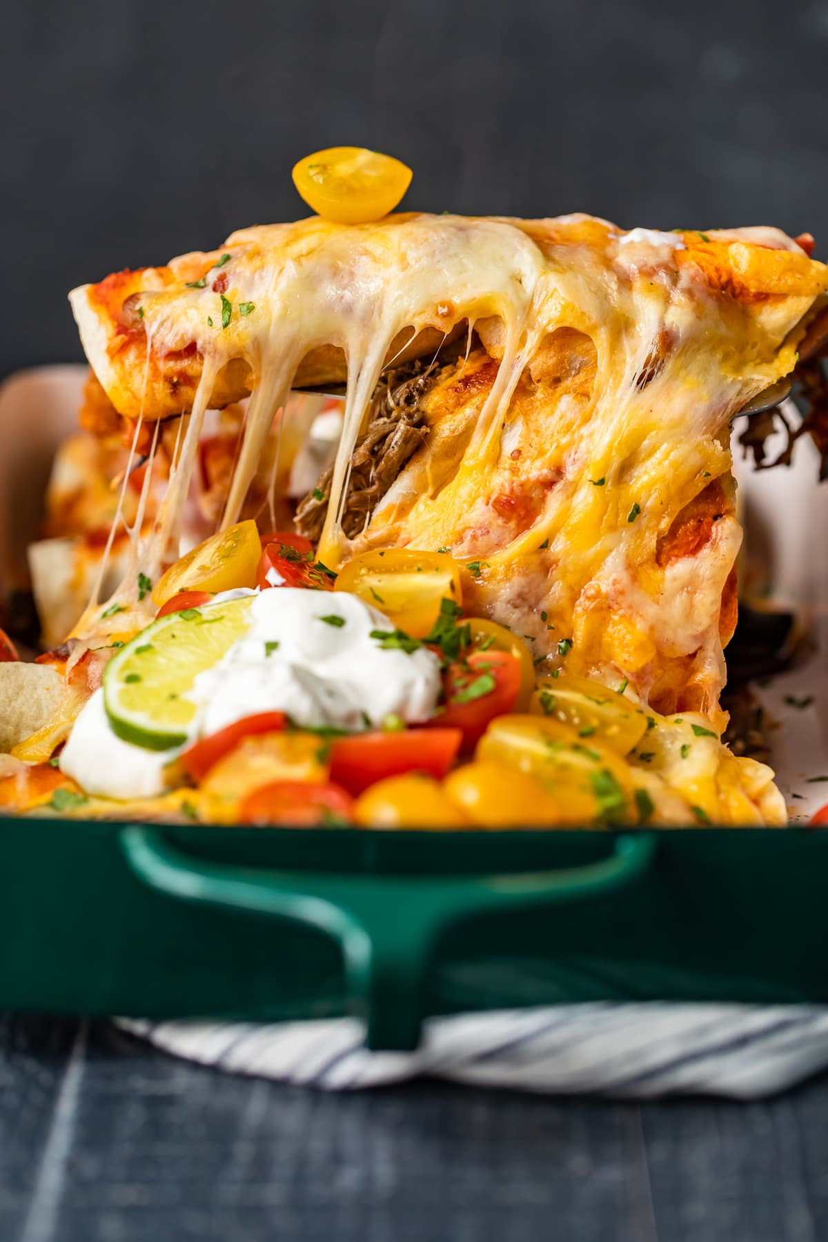 enchiladas filled with shredded beef and cheese
