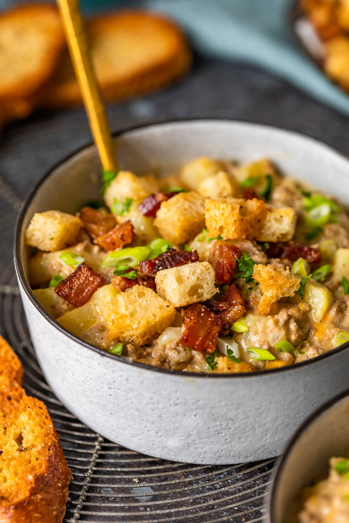 cheeseburger soup topped with bacon croutons