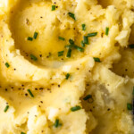 "Vegan Mashed Potatoes are a must for any dairy-free eaters. You can still get creamy, ""cheesy"" mashed potatoes without using cow's milk or butter. These dairy free mashed potatoes are the perfect vegan side dish for any meal, and the flavor is unbeatable!"