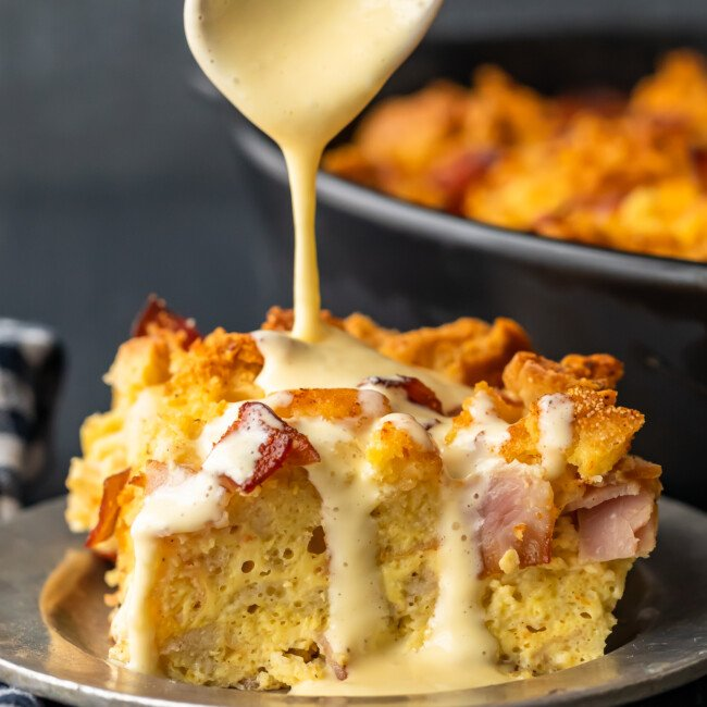 Eggs Benedict Casserole has all the flavor you love from the classic dish, mixed into one super tasty breakfast casserole. This EASY eggs benedict recipe is made with english muffins, filled with ham, and topped off with a simple eggs benedict sauce. This makes the perfect Mother's Day or Easter brunch!