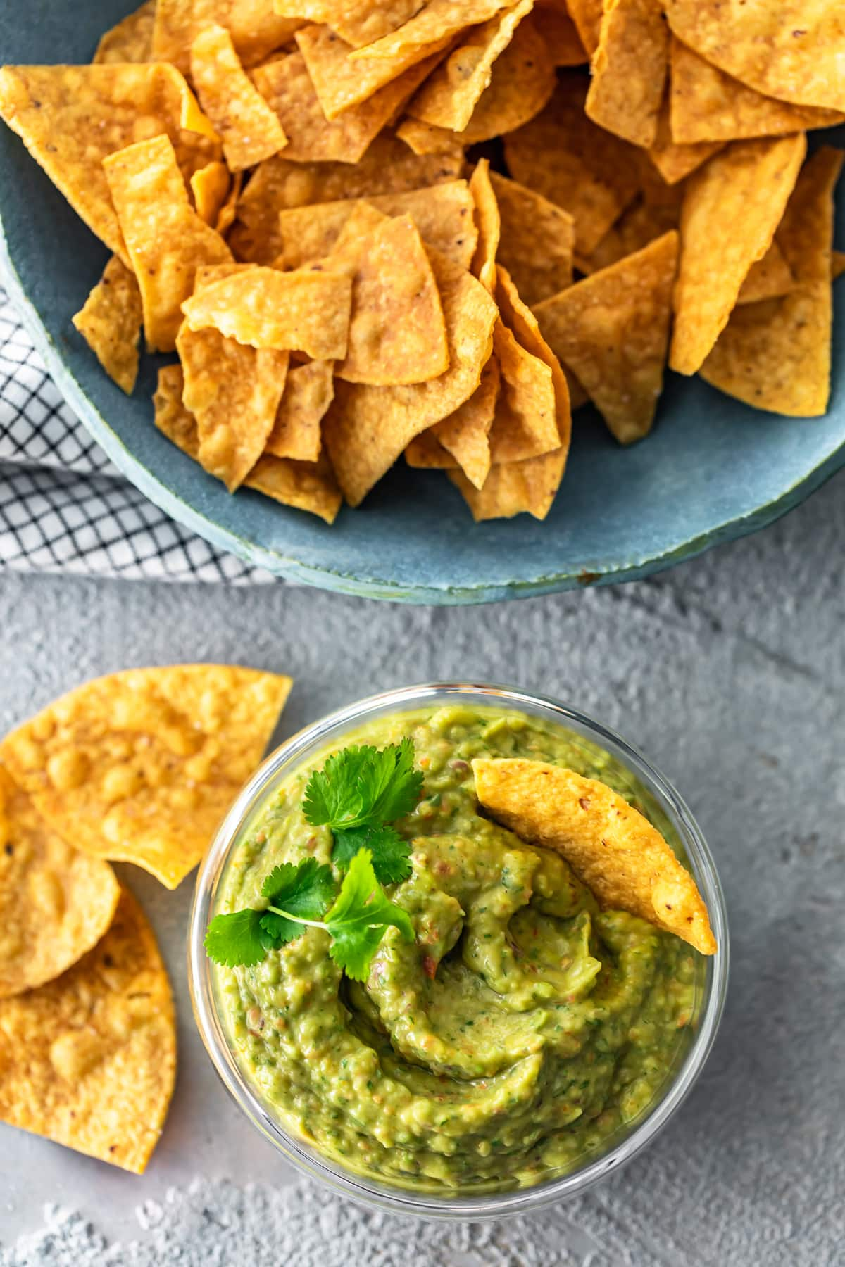 bowl of tortilla chips next to a bowl of dip