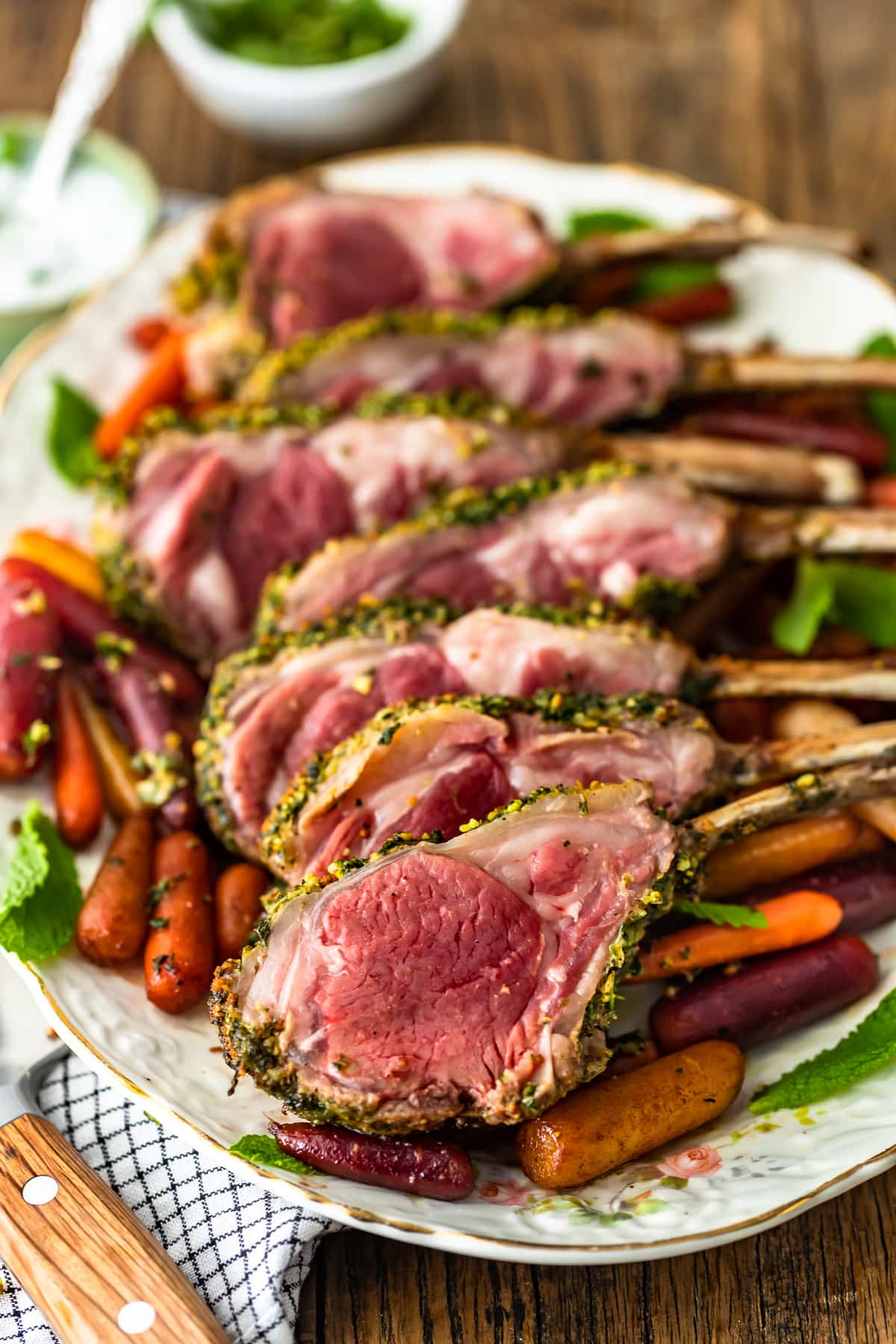 serving platter of roast lamb and carrots