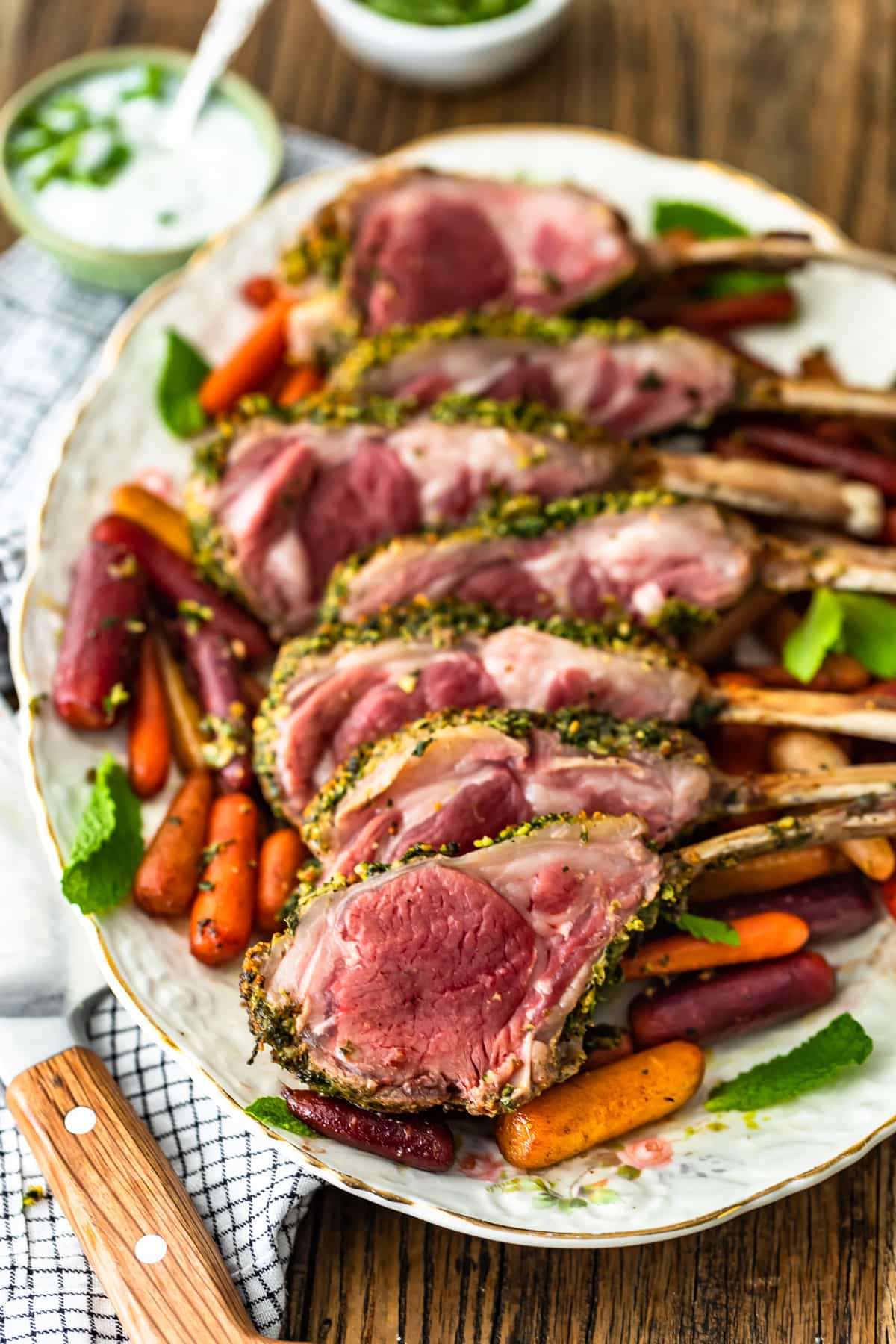 a plate of lamb and carrots