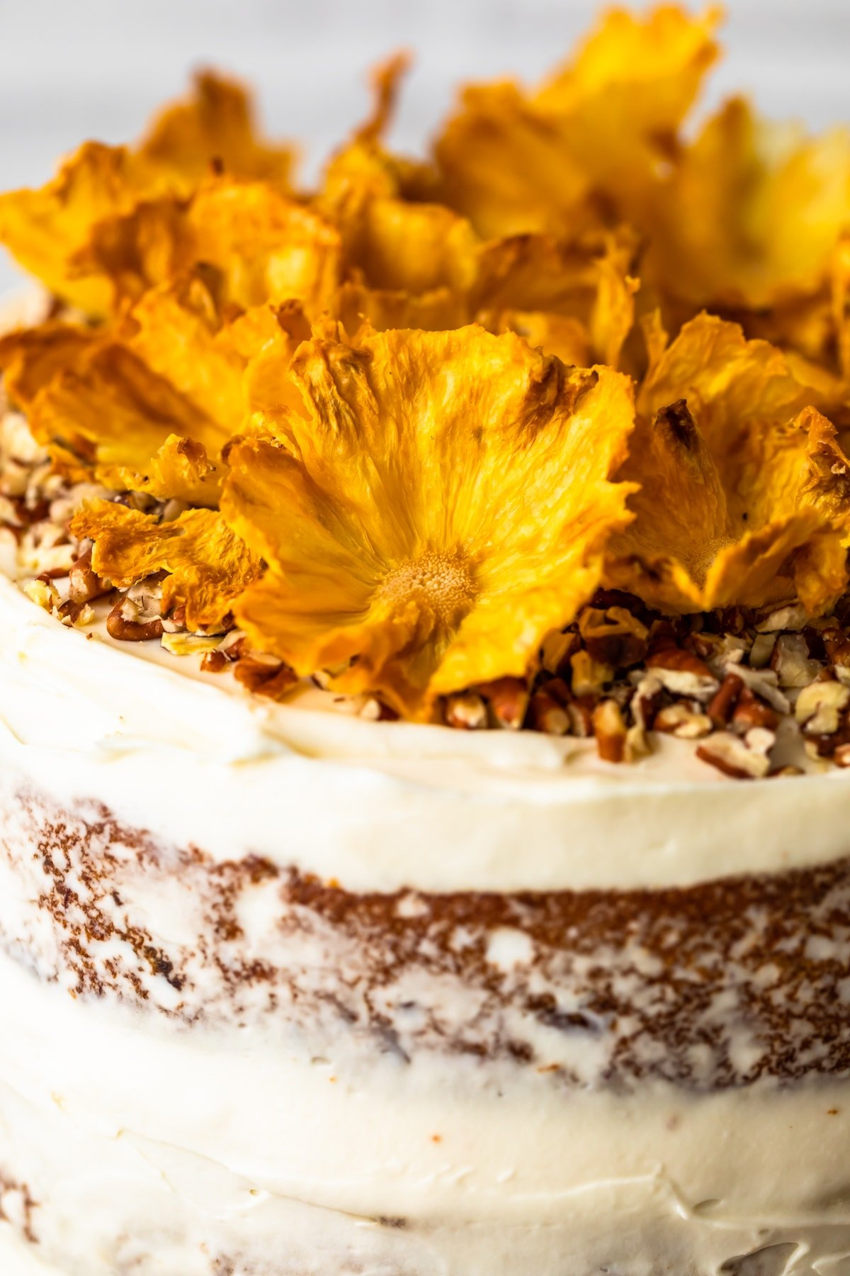 dried pineapple flowers on a cake