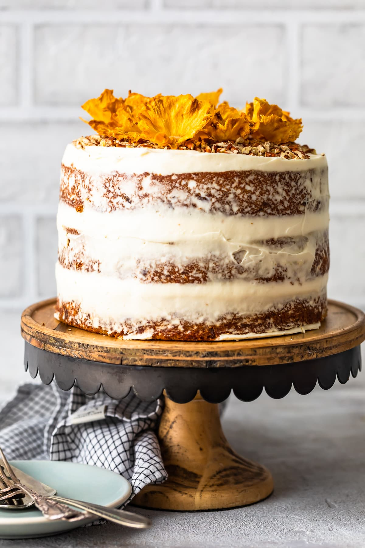 Hummingbird Cake on a cake stand with white brick background