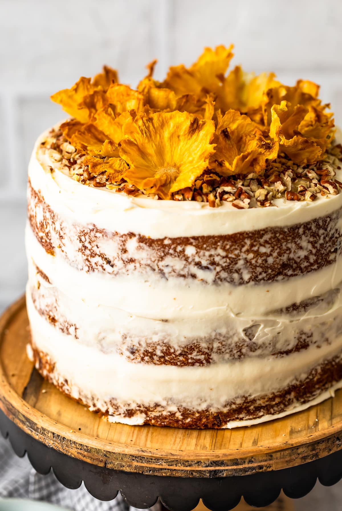 hummingbird cake topped with pecans and dried pineapple