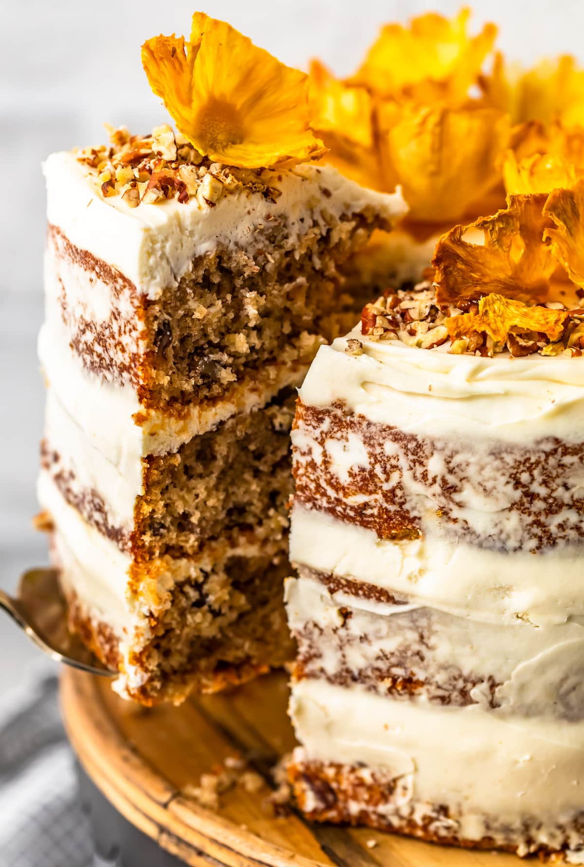 close up on hummingbird cake with a slice taken out