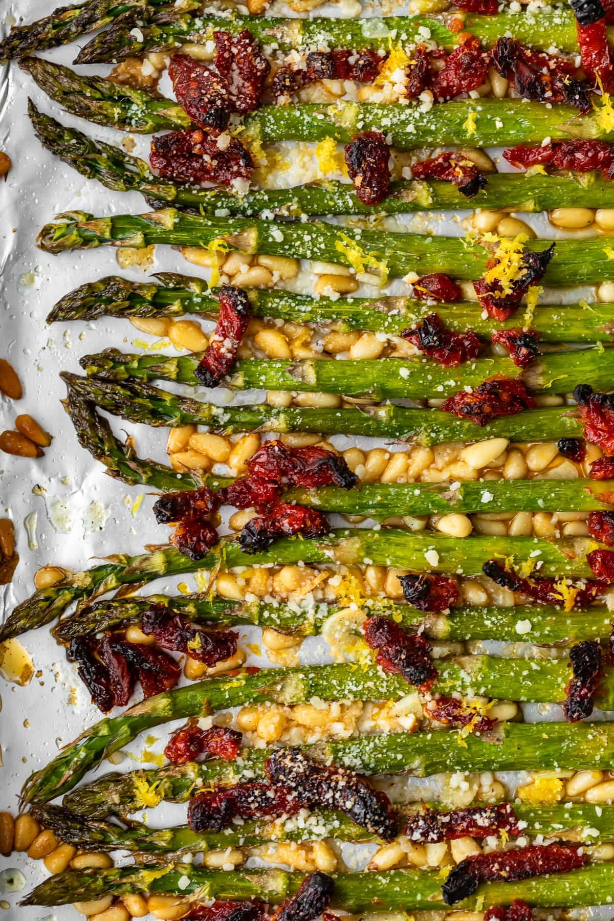 oven roasted asparagus with sun dried tomatoes pine nuts and garlic