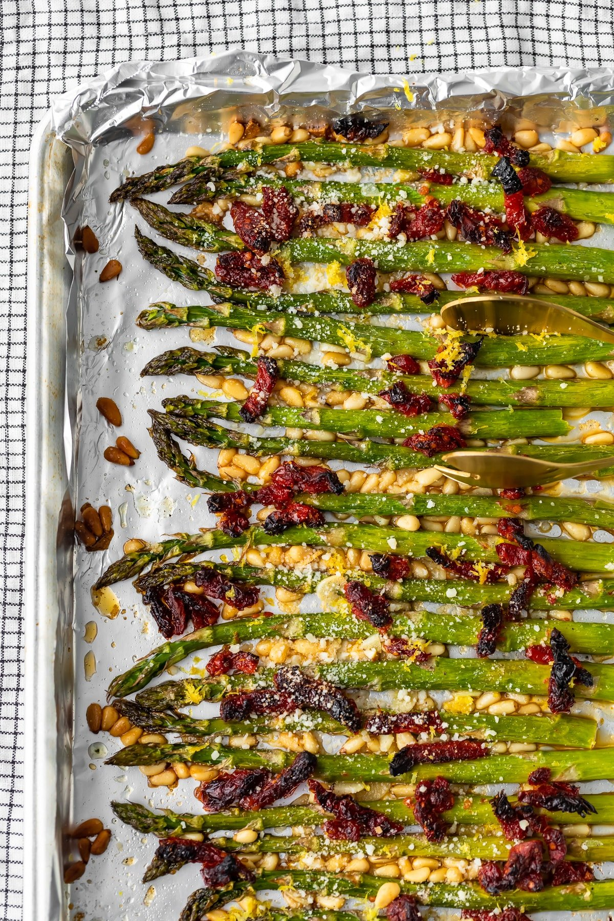 asparagus lined up on a baking sheet
