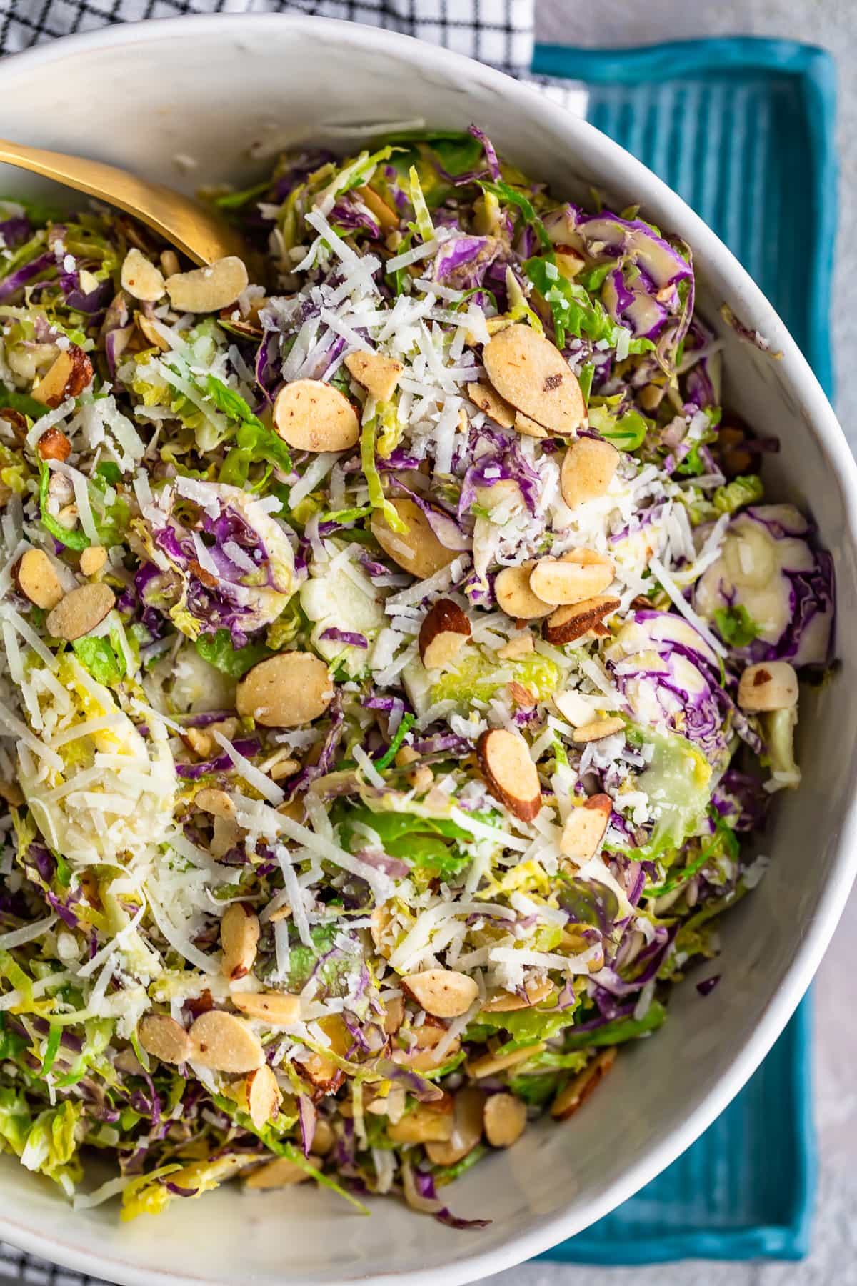 almonds, cheese, and shaved brussels sprouts in a bowl
