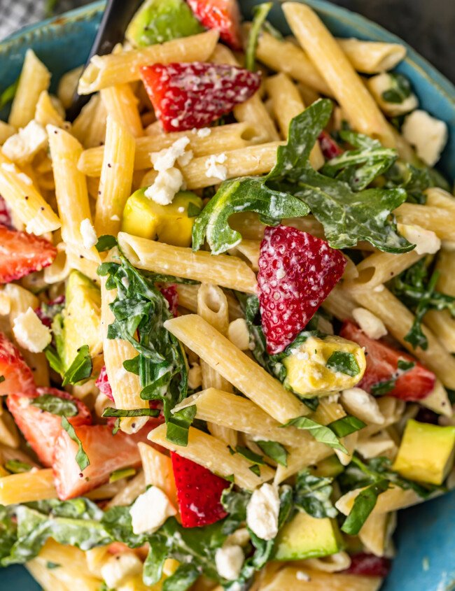 Strawberry Avocado Pasta Salad is an easy and tasty summer pasta salad recipe that everyone will love! This penne pasta salad with feta, strawberries, avocado, poppy seed dressing and more is so light and fresh. Serve it warm or serve it cold, either way, it's sure to be a hit!
