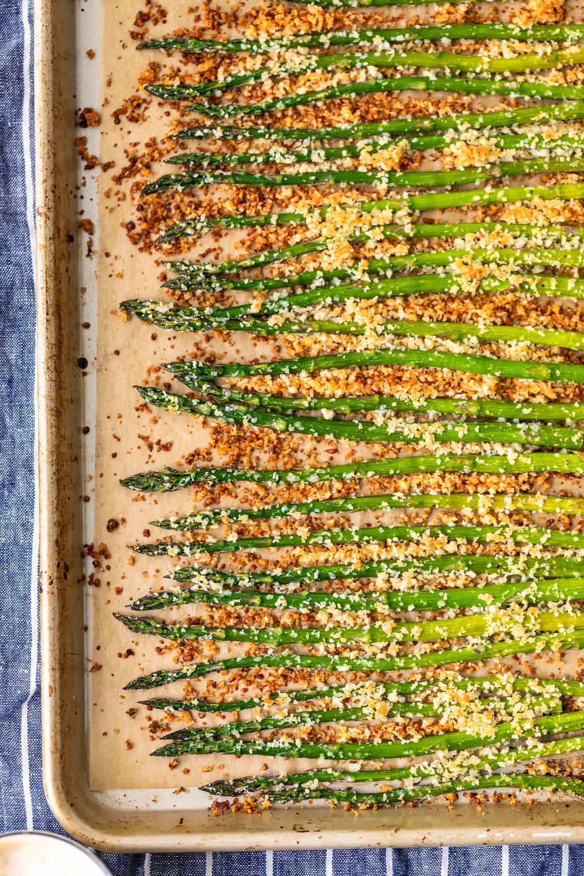 asparagus topped with garlic, parmesan, and breadcrumbs