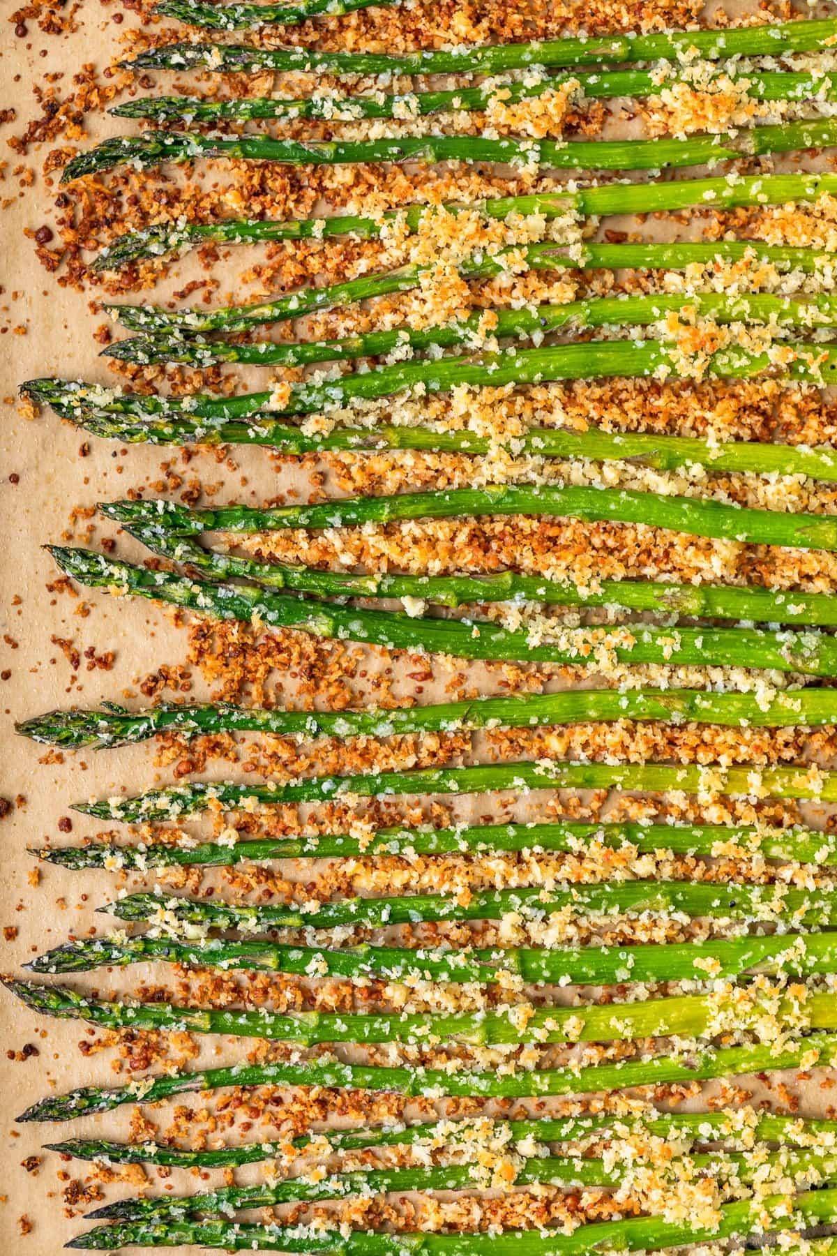 garlic roasted asparagus on a baking sheet