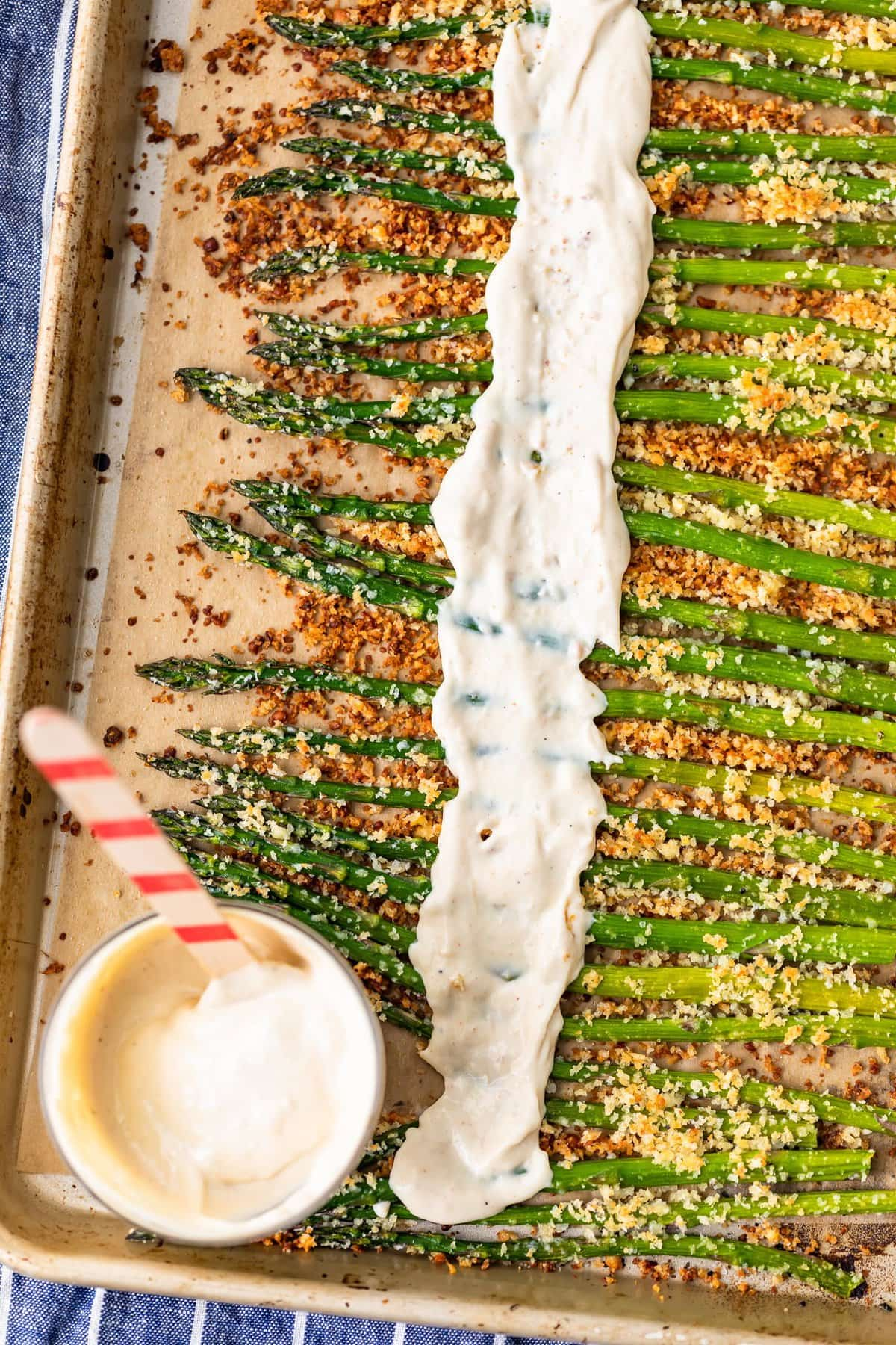 garlic aioli spread over roasted asparagus