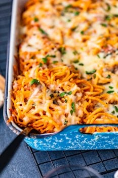 Baked Spaghetti is a cheesy, tasty, easy dinner for any night of the week. This super easy baked spaghetti recipe is something the whole family is sure to love!