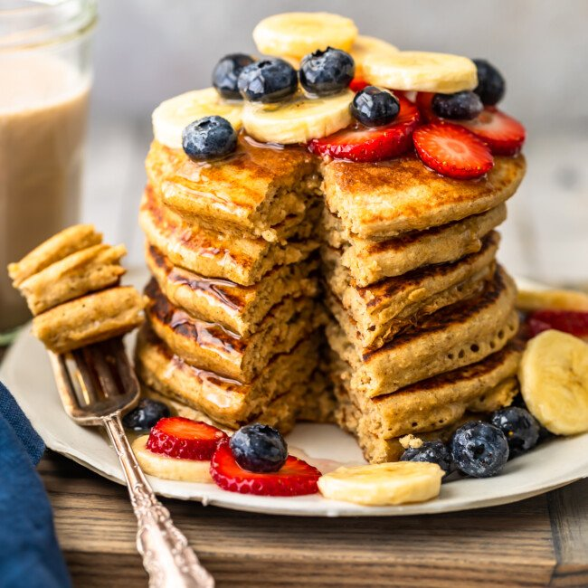 Banana Pancakes are a simple, tasty, healthy recipe you can make for breakfast every morning! These dairy free pancakes are made with almond milk, bananas, oats, and lots of other good stuff. Healthy pancakes for a delicious breakfast! You're going to LOVE this easy banana pancake recipe.