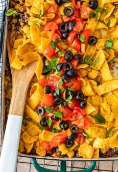 Frito Pie Casserole is an easy recipe with all the best Tex Mex flavors! Layer up the corn chips, beef, cheese, and more in a delicious dish that's perfect for weeknight dinners. Everyone will LOVE this Frito Pie recipe!