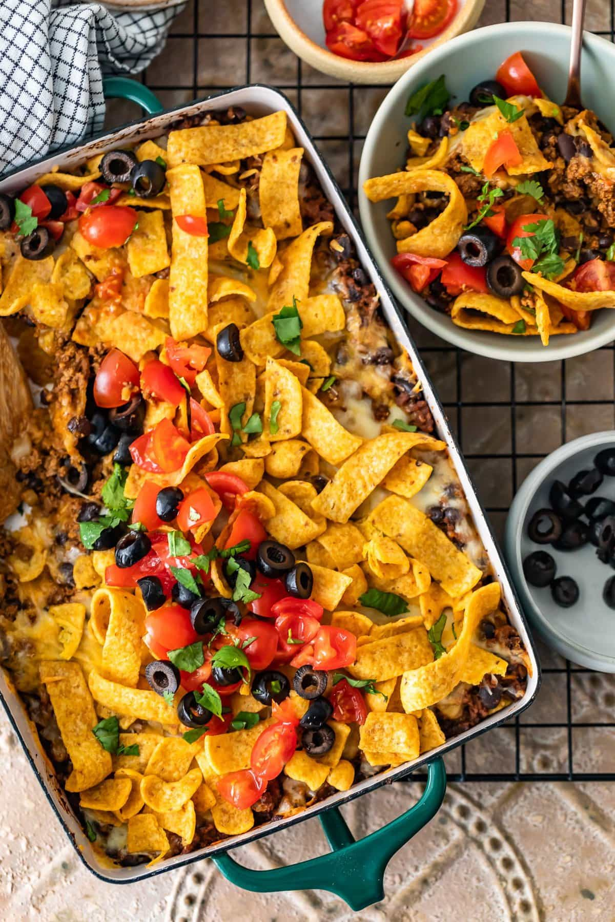 frito pie casserole next to a bowl of frito pie