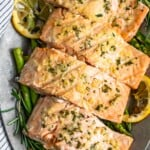 Garlic Butter Salmon is a simple and healthy dish you'll want to be making all summer long! This easy grilled salmon recipe is one of the best and most flavorful. The garlic lemon butter salmon is so light and tasty, and it is just perfect paired with our grilled lemon butter asparagus!