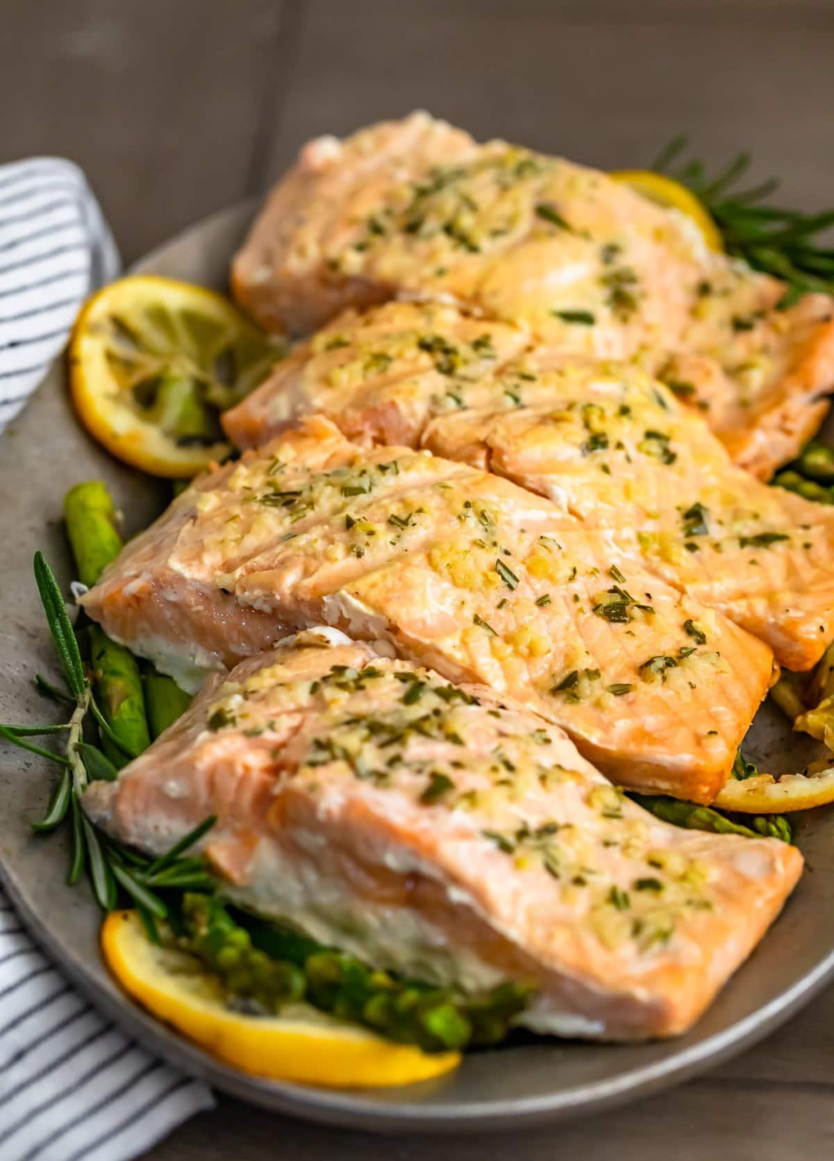 a plate of garlic butter salmon with grilled asparagus