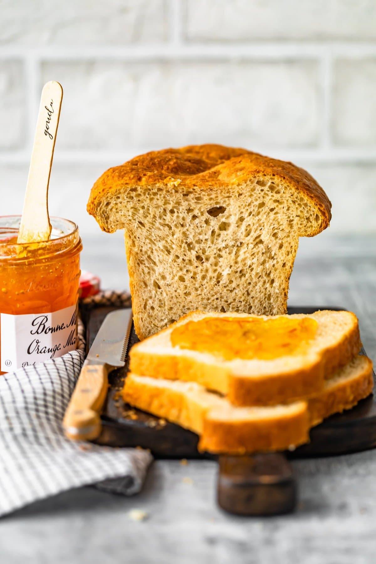 sandwich bread next to a jar of marmalade