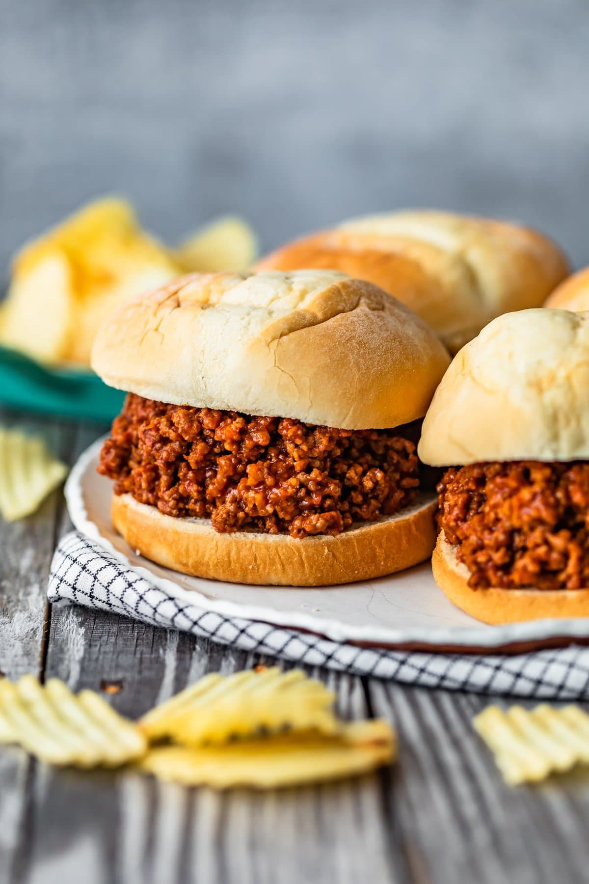 a plate of sloppy joes set on a table