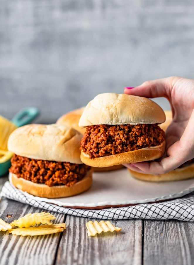 hand picking up a sloppy joe