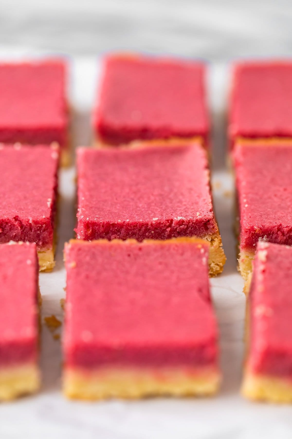 raspberry lemon bars sliced into squares