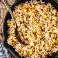 Rice Pilaf is a great side dish for any meal. Make it better by spicing it up with some cinnamon, apples, and raisins like we did in this easy rice pilaf recipe! It's perfect for holidays or any hearty dinner.
