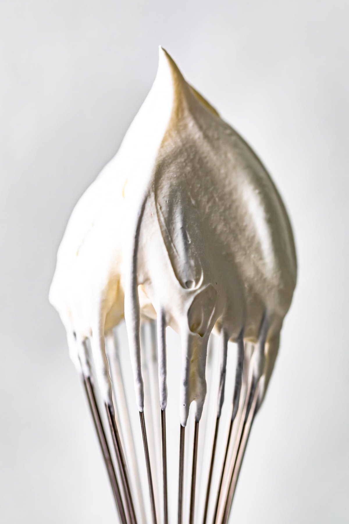 a whisk with whipped cream