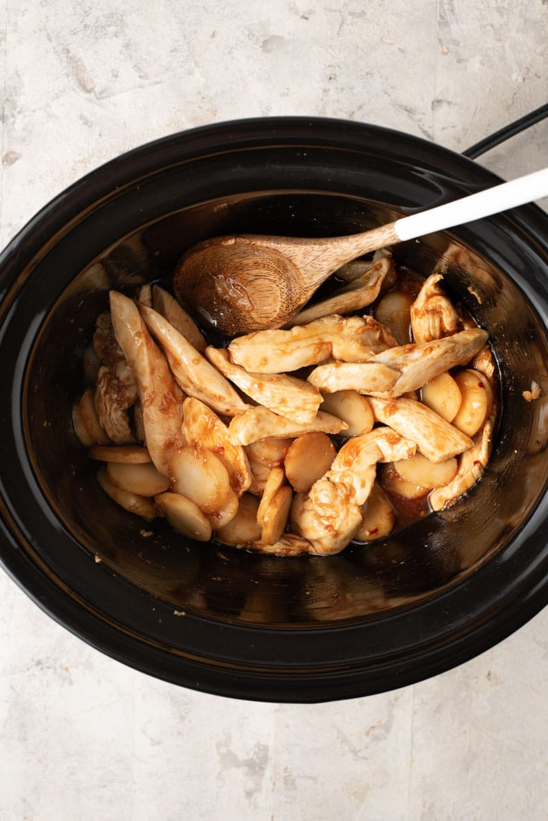 An overhead shot of cashew chicken in a slow cooker