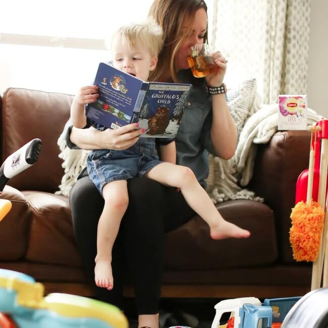 mom drinking lipton stress less tea while reading to son