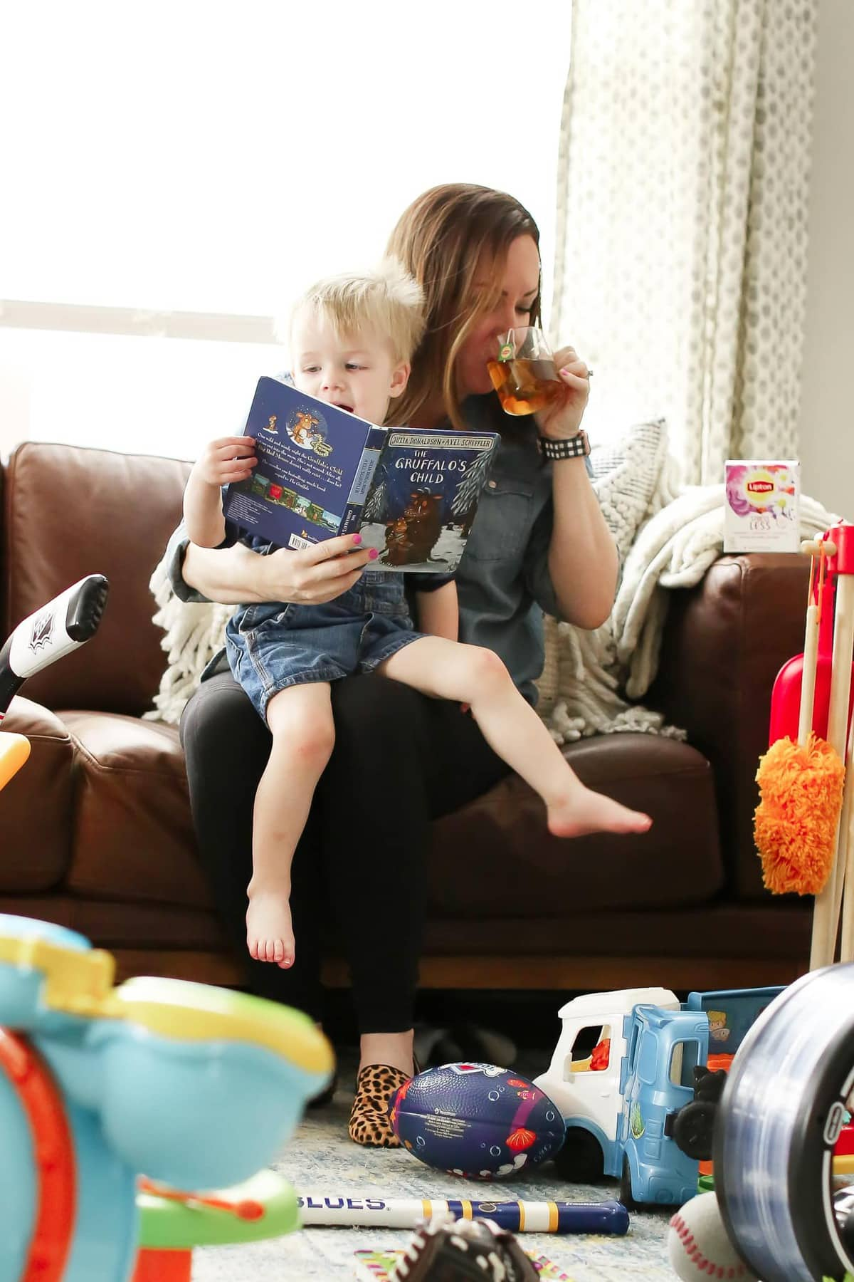 mom drinking lipton stress less tea while reading to son