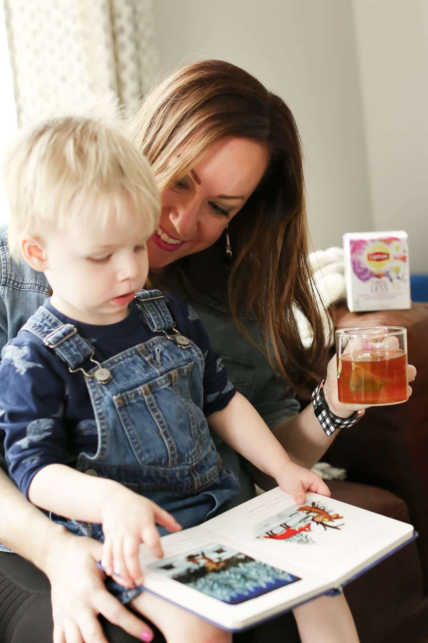 mom reading son book while drinking lipton stress less tea