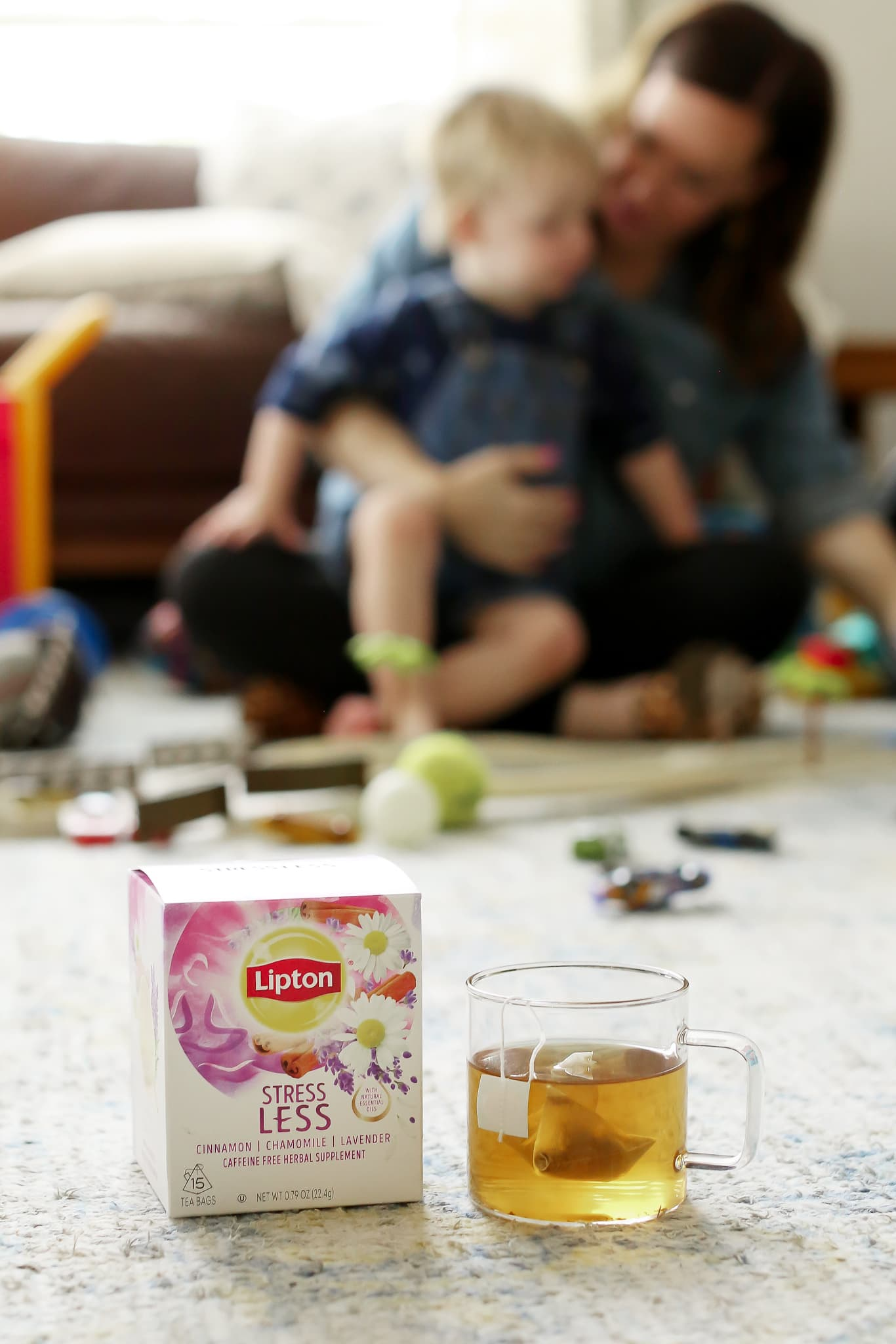 playing with son on ground while enjoying lipton stress less tea