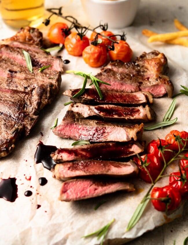 sliced new york strip steak on a plate