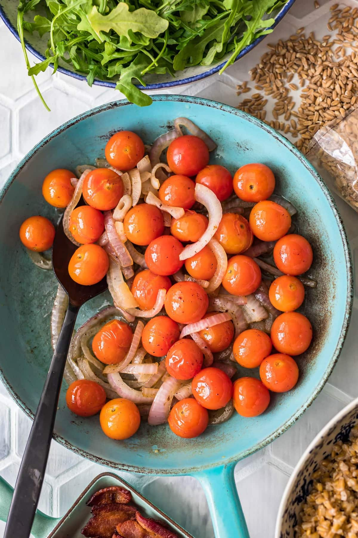 a bowl of cherry tomatoes and sliced onion