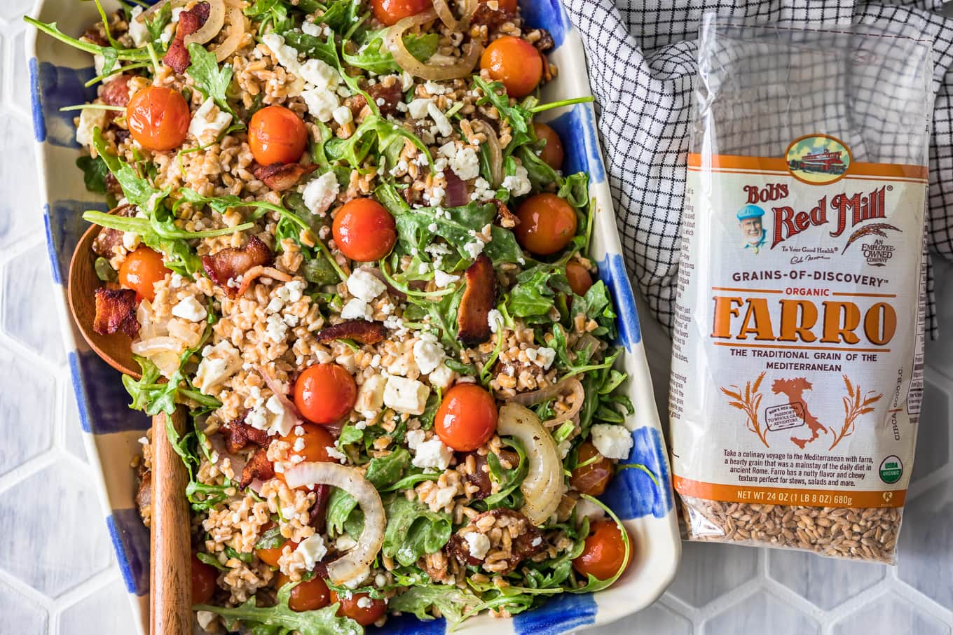 a plate of salad next to a bag of farro