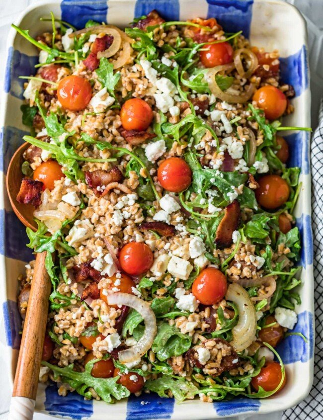 blt farro salad in blue and white checkered serving dish