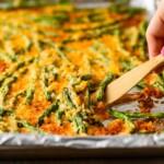 spatula lifting up green beans from pan