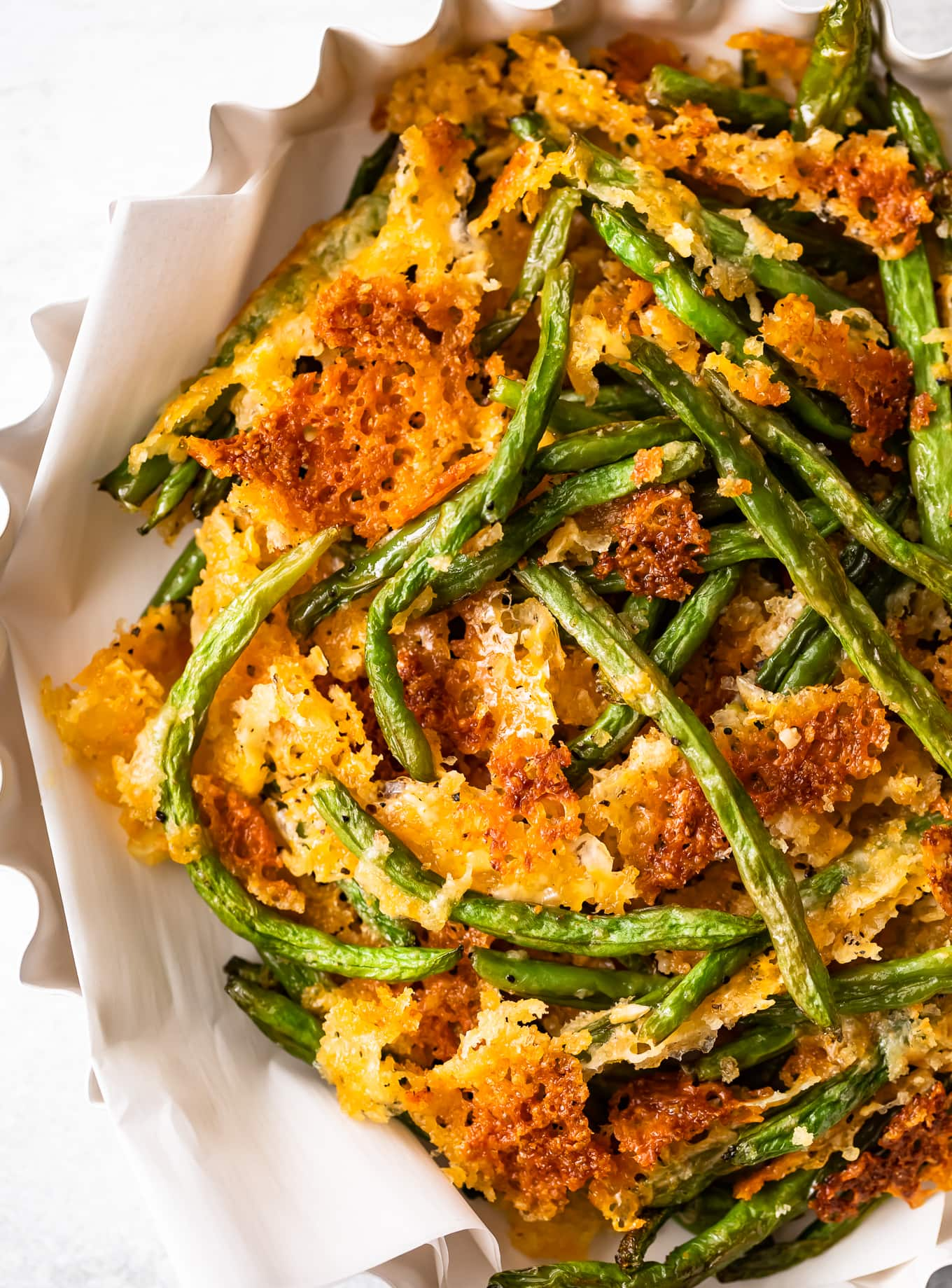 Close up of crispy baked green beans in a serving dish