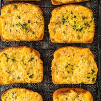overhead shot of cheesy garlic bread on texas toast