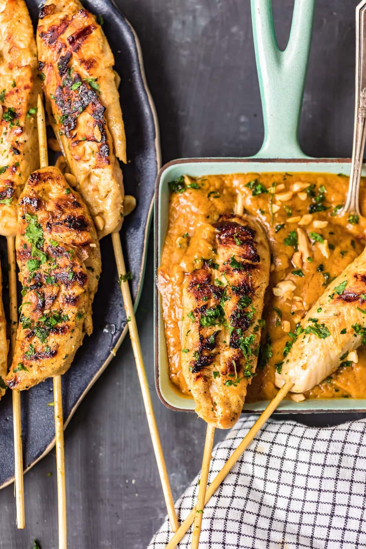 chicken satay dipped into peanut sauce