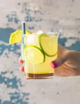 hand holding glass of homemade limeade