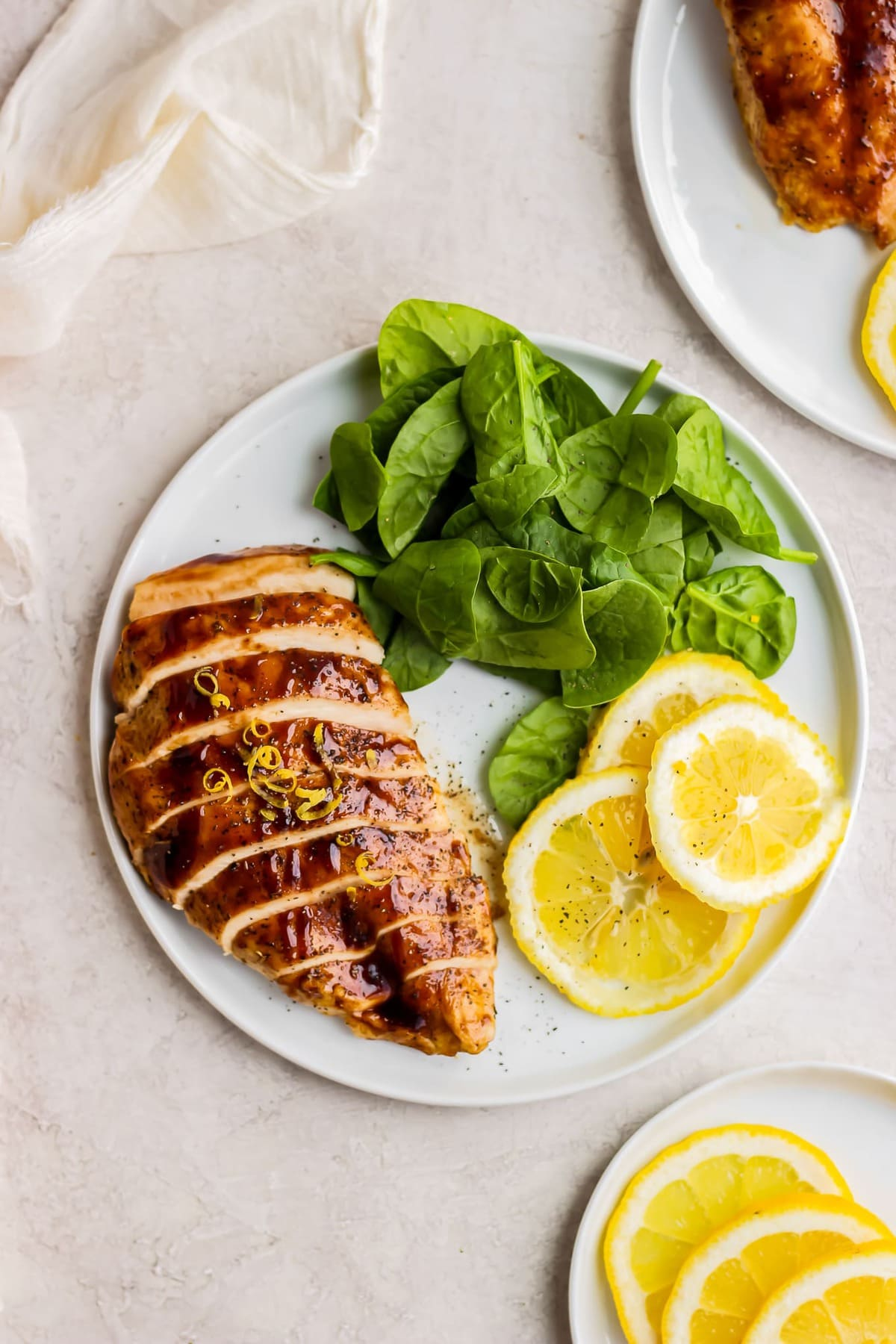 plate of chicken breast and spinach